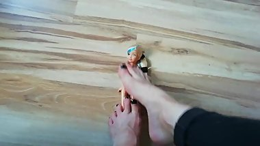 Foot domination doll