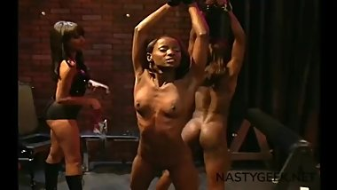 a black whore with big ass performs sadomasochistic sex on two other whores
