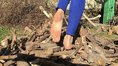 Hot young sexy teen step on chopped wood with bare feet