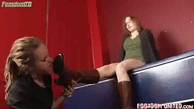 Lesbian slave girl uses her tongue to polish Mistress's boots