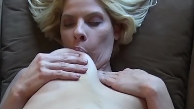 Kinzy Jo Sucks Her Tits and Gets Fucked by a Ten Inch Toy.