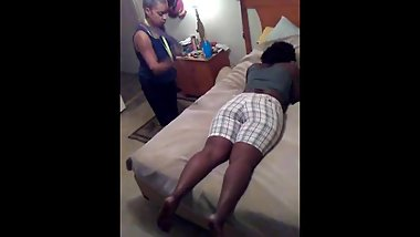 Leshanda gets spanked on the bed for wearing dress shorts to church